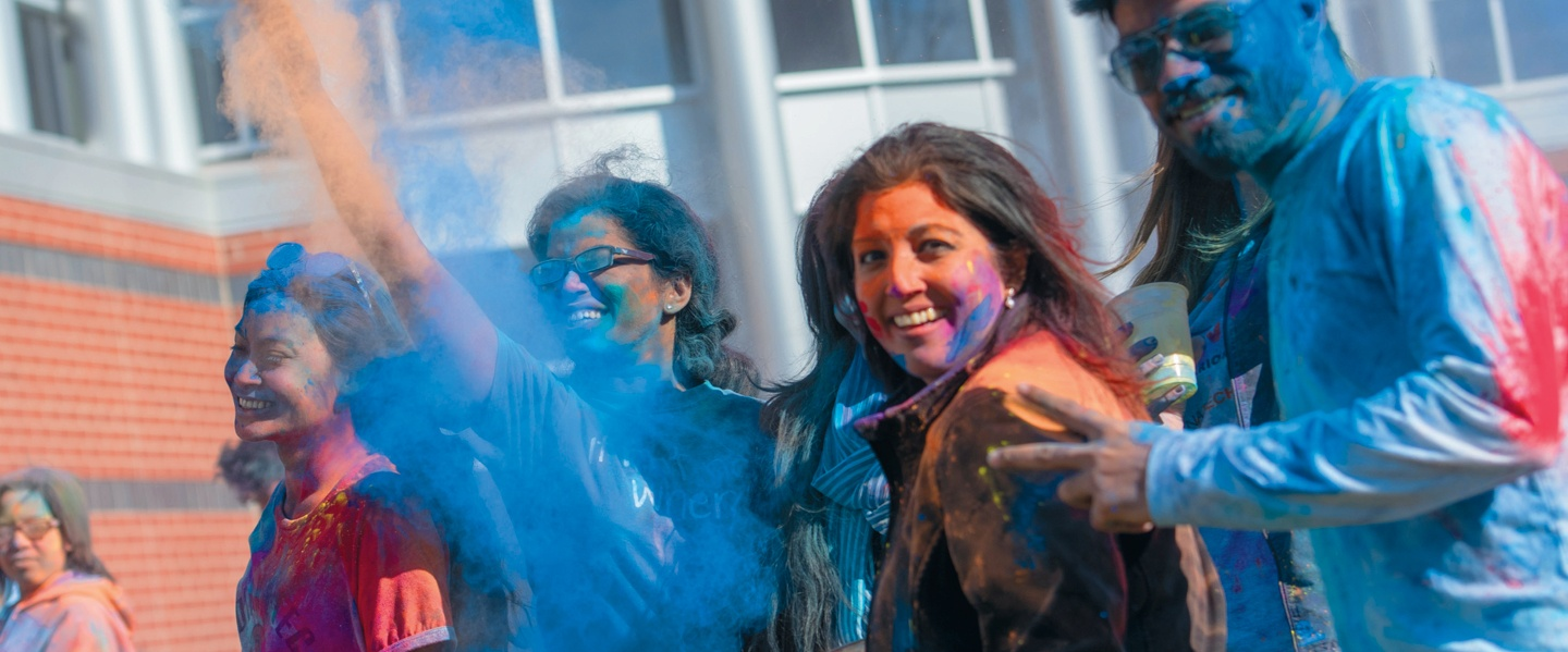 Students and faculty celebrating Holi Festival on campus